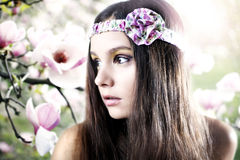 Girl and magnolia Royalty Free Stock Image