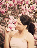 Girl and Magnolia flowers Royalty Free Stock Photo