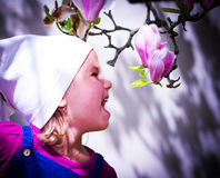 Girl and magnolia Royalty Free Stock Images