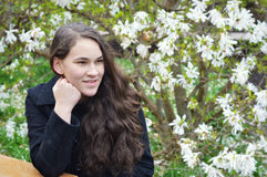 Girl by Magnolia Tree Royalty Free Stock Images