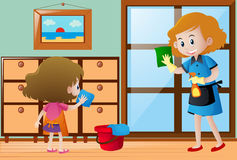 Girl and maid cleaning the house Stock Photography