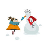 A girl make friends with snowman. Royalty Free Stock Photography