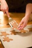 Woman bake Gingerbread Angels Royalty Free Stock Photos
