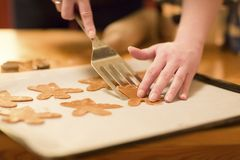 Baking Gingerbread Angels for Christmas Royalty Free Stock Image