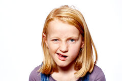 Girl make grimaces. Girl with red hair make grimaces royalty free stock images