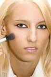 Girl Make Her Make-up Stock Image
