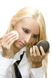Girl make her make-up Stock Photography