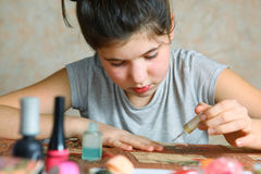 Girl make manicure and dry polished nails Royalty Free Stock Photography