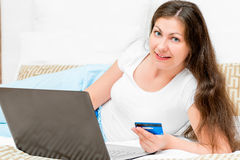 Girl make purchases at online Stock Image