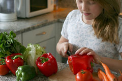 Girl make salad. Girl learning to making the salad Royalty Free Stock Photography