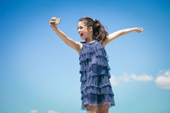 Girl make selfie against blue sky Stock Photo