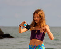 The girl make a selfie on the sea beach. Royalty Free Stock Photo