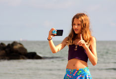 The girl make a selfie on the sea beach. Royalty Free Stock Image