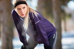 Girl make short break from running. Breathless girl make short break from running Royalty Free Stock Photography