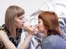 Girl make-up artist at work Royalty Free Stock Photos