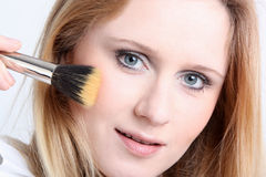 Girl with make up brush Stock Photos