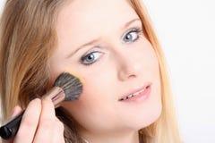 Girl with make up brush Stock Image