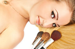 Girl with make-up brushes Royalty Free Stock Photos