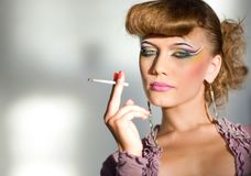 Girl with make-up and with cigarette Stock Photo