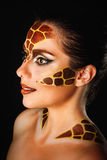 Girl with make-up giraffe Royalty Free Stock Photos