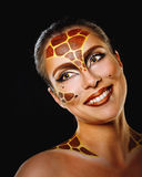 Girl with make-up giraffe Royalty Free Stock Photography