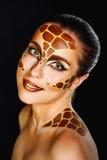 Girl with make-up giraffe Stock Photos