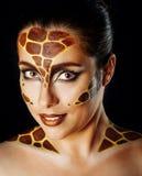 Girl with make-up giraffe Royalty Free Stock Photos
