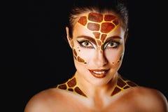 Girl with make-up giraffe Stock Photography