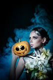Girl with make-up for Halloween. Pumpkin Stock Photos