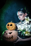 Girl with make-up for Halloween. Pumpkins Stock Images