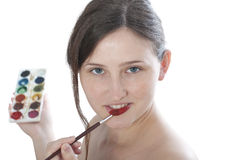 Girl without make-up paints watercolor lips Royalty Free Stock Photography