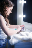 girl in a make-up room in front of the mirror Royalty Free Stock Photos