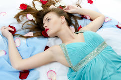 girl with a make-up and roses Stock Photos