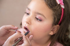 Girl and make up. Six years girl being make up by her mother stock photography