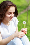 Girl make a wish. Beautiful caucasian summer teenage girl making a wish Stock Photo