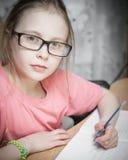 Girl make written lessons. Stock Photography