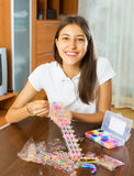 Girl makes braslets with elastic Stock Image