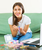Girl makes braslets with elastic Stock Photo