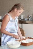 Girl makes cake in kitchen Stock Image