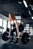 The girl makes the dead lift stock images