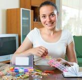 Girl makes decorative bracelet Royalty Free Stock Photography