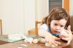 A girl makes dough figurines Royalty Free Stock Image