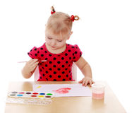 Girl makes drawing water color paints sitting at Royalty Free Stock Image