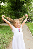 Girl makes faces imitate witch. Cute beautiful girl makes faces imitate witch Royalty Free Stock Images