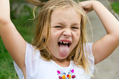 Girl makes faces imitate witch. Cute beautiful girl makes faces imitate witch Stock Images