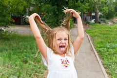 Girl makes faces imitate witch. Cute beautiful girl makes faces imitate witch Royalty Free Stock Image