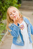 Girl makes faces imitate witch. Cute beautiful girl makes faces imitate witch Royalty Free Stock Photo