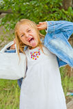 Girl makes faces imitate witch Royalty Free Stock Image