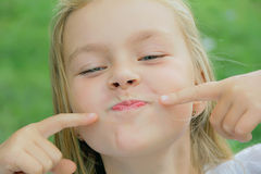 Girl makes faces Stock Photo