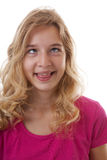 Girl makes funny face in closeup over white background Royalty Free Stock Images